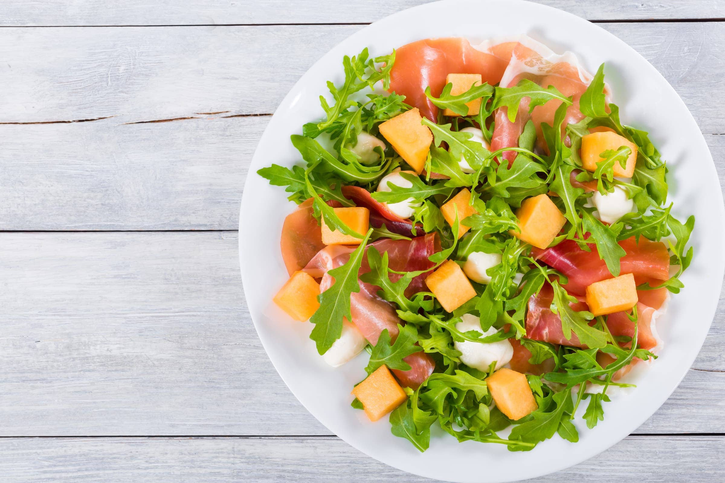 Ricetta Insalata di Melone, Rucola, Prosciutto Crudo e Mozzarella